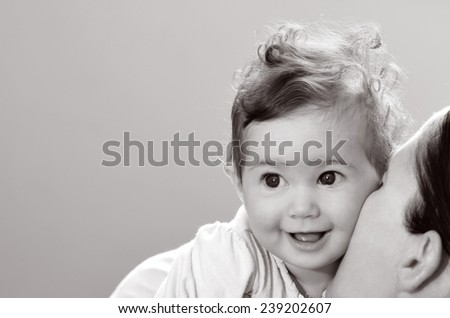 Happy baby (girl age 06 months) smiles. Concept photo childhood.copy space (BW) - stock photo
