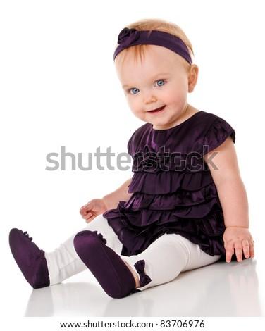 Happy Baby Girl in purple dress - stock photo