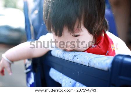 Happy baby girl in Stroller - stock photo