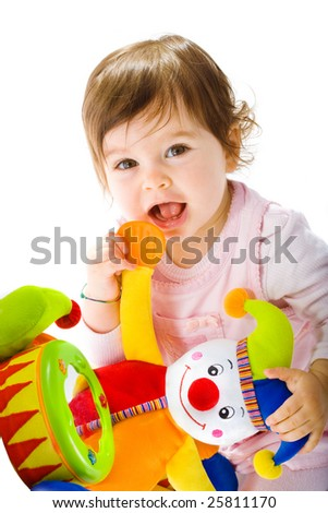 Happy baby girl playing with toy clown smiling, cotout on white background. - stock photo