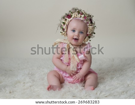 Happy Baby Girl Wearing Flower Hat - stock photo
