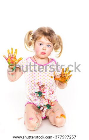 Happy baby girl with her hands in paint isolated on white. Art concept - stock photo