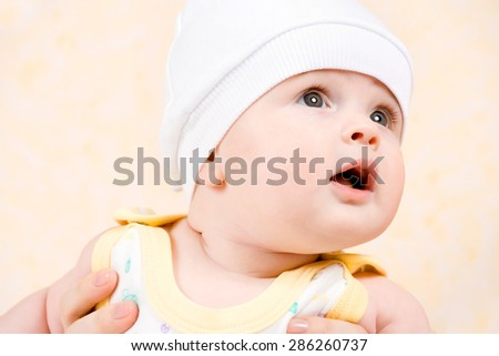 happy baby in a white hat - stock photo