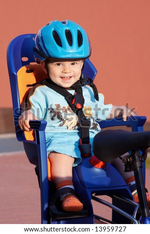 happy baby in bicycle chair - stock photo