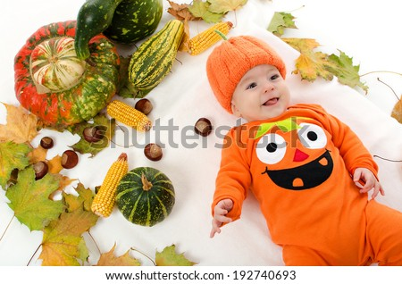 Happy baby infant in Jack O Lantern pumpkin outfit - stock photo