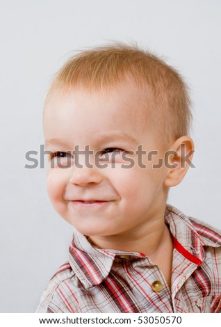 Happy baby on a light background.leer. - stock photo