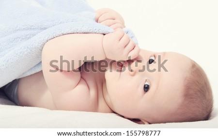 happy baby on back - stock photo