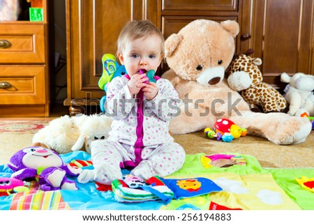 happy baby on colorful play mat at home - stock photo