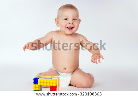 Happy baby playing in the constructor - stock photo