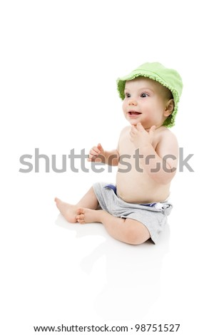Happy baby wearing shorts and sun hat. - stock photo