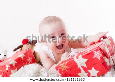 Happy baby with presents - stock photo