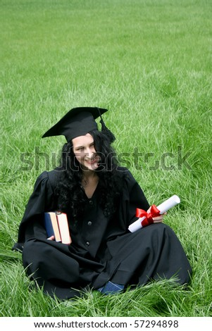 Happy bachelor with diploma - stock photo