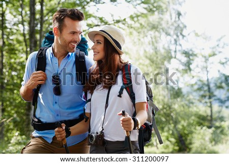 Happy backpackers couple hiking - stock photo