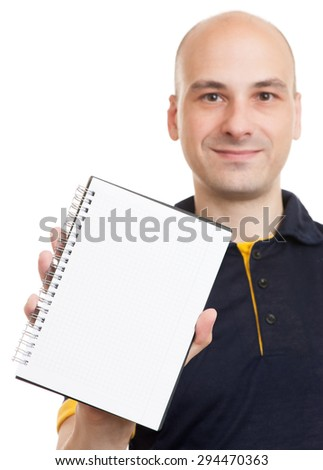 happy bald man showing blank notepad with copy space - stock photo
