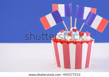 Happy Bastille Day cupcake with red, white and blue french flags.  - stock photo