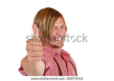Happy Bavarian man with oktoberfest leather trousers (Lederhose) shows thumb up.  Isolated on white background. - stock photo