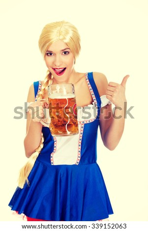 Happy bavarian woman with beer and thumbs up. - stock photo