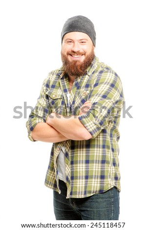 Happy bearded man. Handsome young bearded man keeping arms crossed and smiling while standing against white background - stock photo