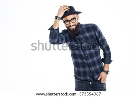 Happy bearded young african man in black hat and glasses standing and smiling - stock photo