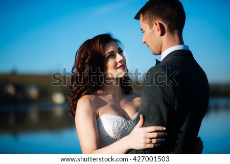Happy beautiful bride gorgeous brunette and beautiful bride in a white dress, holding close-up - stock photo