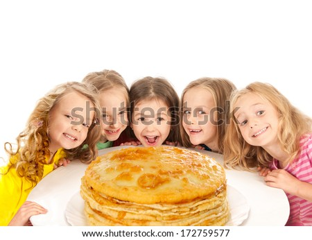 Happy beautiful children with pancakes - stock photo