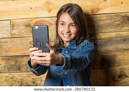 Happy beautiful cute girl making selfie - stock photo