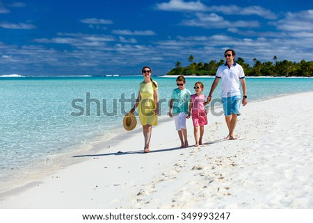 Happy beautiful family on a tropical beach vacation - stock photo