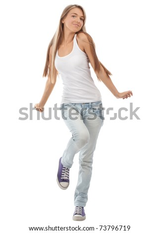 Happy beautiful girl dancing and celebrating standing in full length, isolated on white background - stock photo