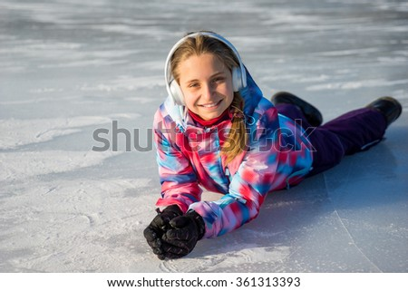 Happy beautiful girl in headphones enjoying winter holidays - stock photo