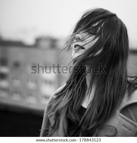 happy beautiful girl on a windy day - stock photo