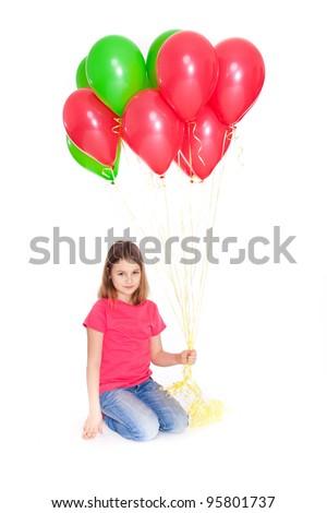 Happy beautiful girl with baloons looking at camera - stock photo