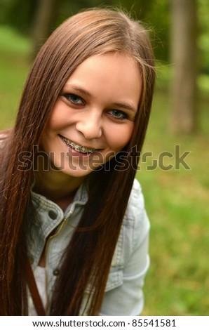 happy beautiful girl with braces - stock photo