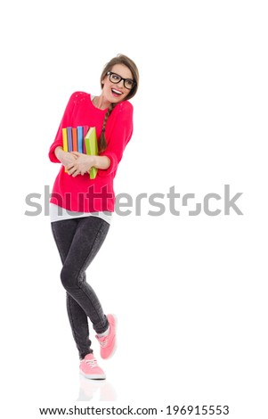 Happy beautiful girl with stack of books. Full length studio shot isolated on white. - stock photo