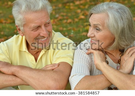 happy beautiful Senior couple in autumn park - stock photo