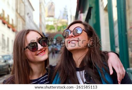 Happy beautiful student girls on the street - stock photo