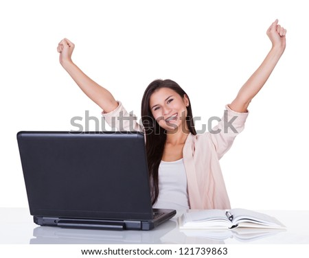 Happy beautiful vivacious female office worker or businesswoman rejoicing raising her hands high in the air - stock photo