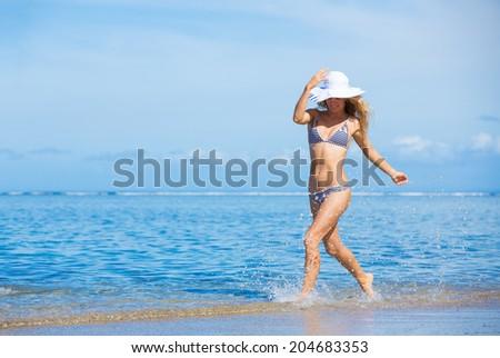 Happy beautiful woman enjoying sunny morning at the beach f - stock photo