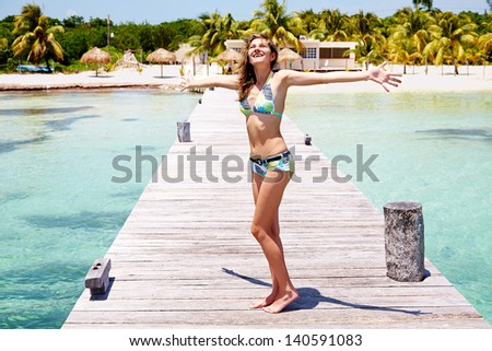 Happy beautiful woman have enjoyment at tropical resort - stock photo