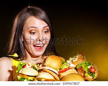 Happy beautiful woman holding group hamburger. - stock photo