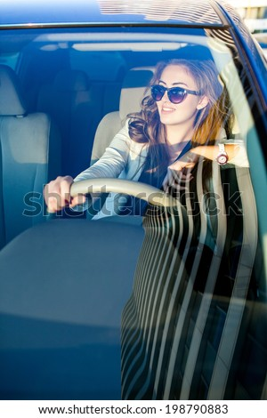Happy beautiful woman in sunglasses traveling by  new  car - stock photo