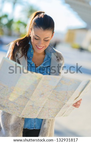 Happy Beautiful Woman Looking In Map, Outdoors - stock photo