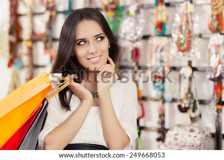 Happy Beautiful Woman Shopping  - Portrait of a young girl with shopping bags in trendy store   - stock photo