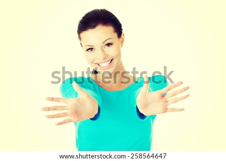 Happy beautiful woman showing her palms. - stock photo