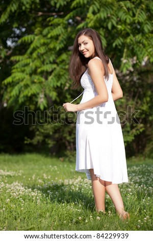 happy beautiful woman walking in the park - stock photo