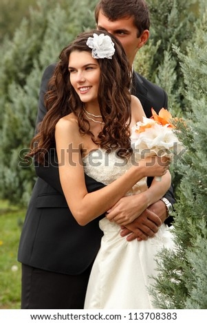happy beautiful young bride with groom in love summer nature outdoor - stock photo