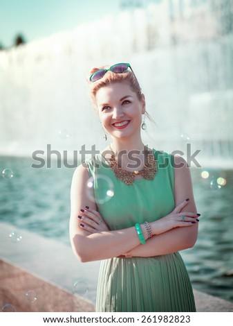Happy beautiful young girl with braces in vintage clothing outdoor - stock photo