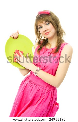 happy beautiful young housewife washing the dishes with a sponge - stock photo
