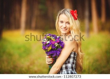 Happy beautiful young woman outdoors in autumn park - stock photo