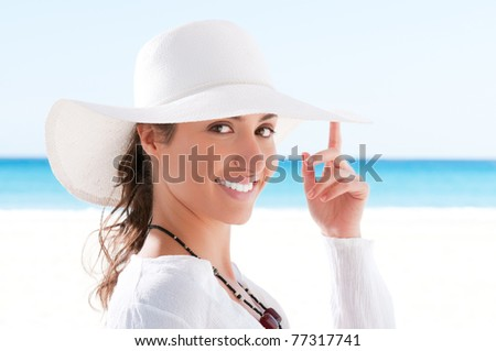 Happy beautiful young woman smiling and looking at camera at summer beach - stock photo