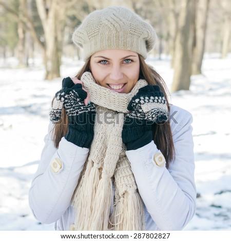 Happy Beautiful Young Woman Winter Season in the park. Caucasian female wintertime portrait outdoor. - stock photo